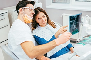 Dentist and patient looking at a dental x-ray.